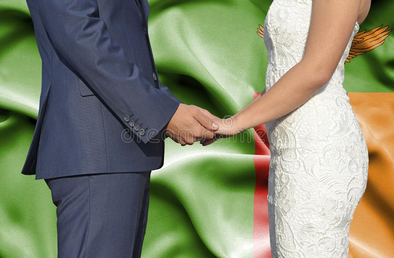 Husband and Wife holding hands - Conceptual photograph of marriage in Zambia royalty free stock photos