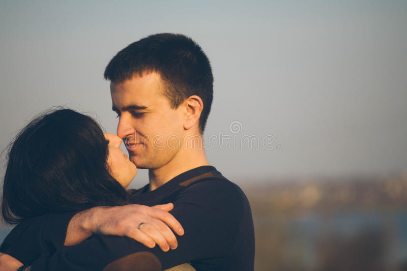 Husband and wife in nature, early spring. Happy couple on vacation. Lovers are laughing. guy and girl. enjoy each other in the eve royalty free stock images