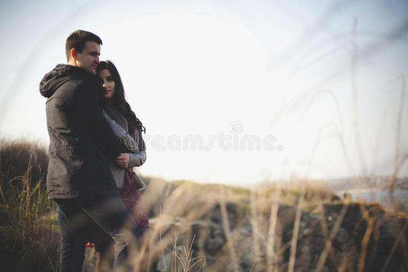 Husband and wife in nature, early spring. Happy couple on vacation. Lovers are laughing. guy and girl. enjoy each other in the eve. Happy couple on vacation royalty free stock photo