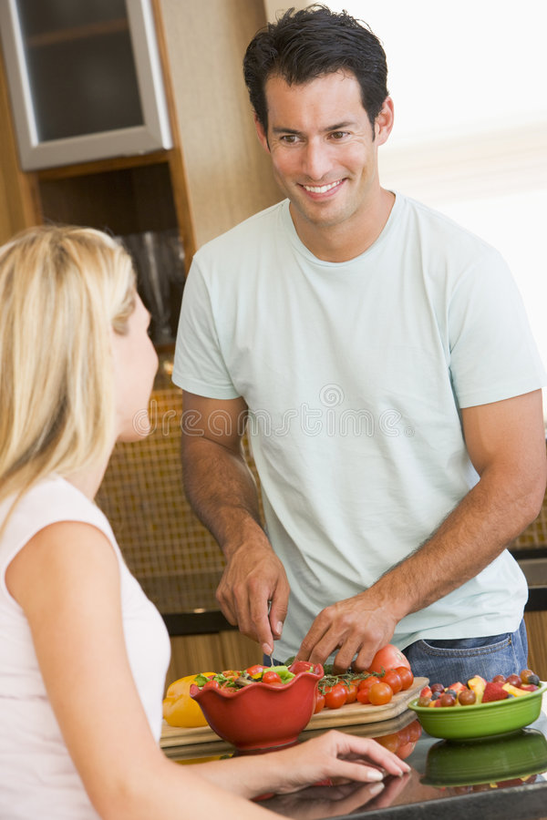 Husband And Wife Preparing Dinner royalty free stock images
