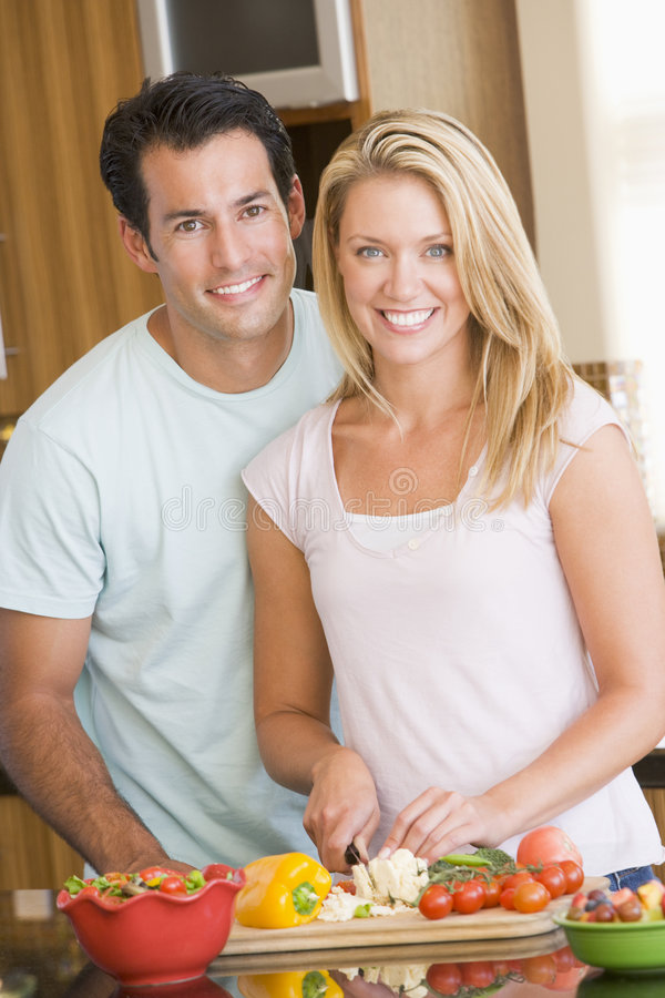 Husband And Wife Preparing meal stock photos