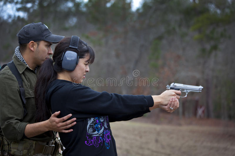Download Husband And Wife Shooting Lesson Stock Images - Image: 22686874