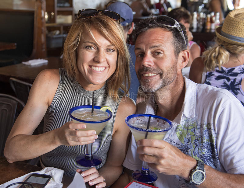 Download Husband And Wife Toasting Margaritas Stock Photo - Image: 83721533