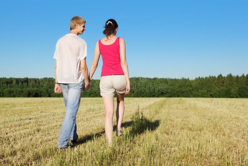 Husband, Wife Walking In Beautiful Field Royalty Free ...