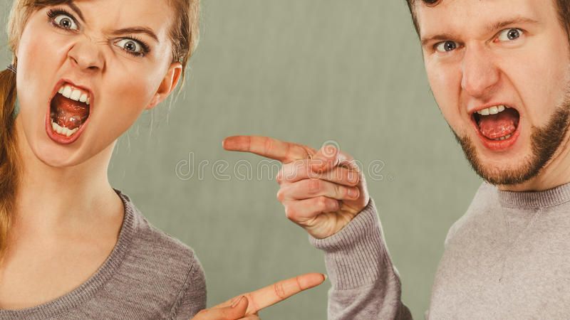 Husband and wife yelling and arguing. stock photos
