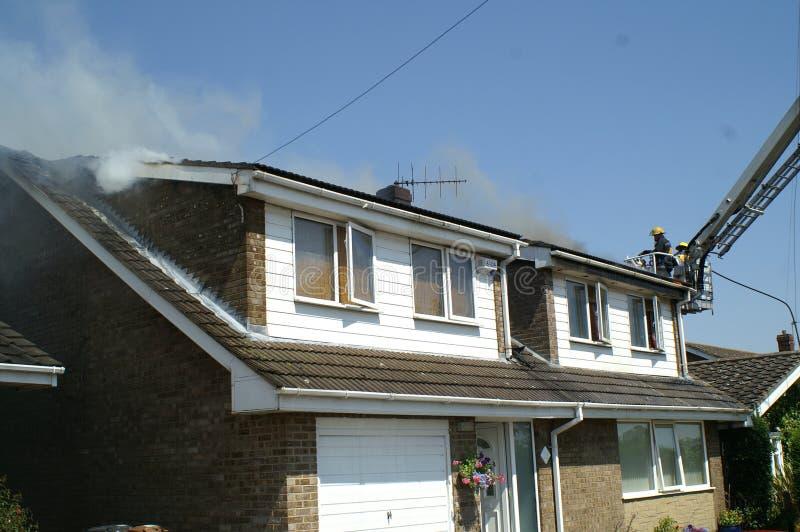 Husbrand, avfyrar det skadade hemmet, royaltyfri bild
