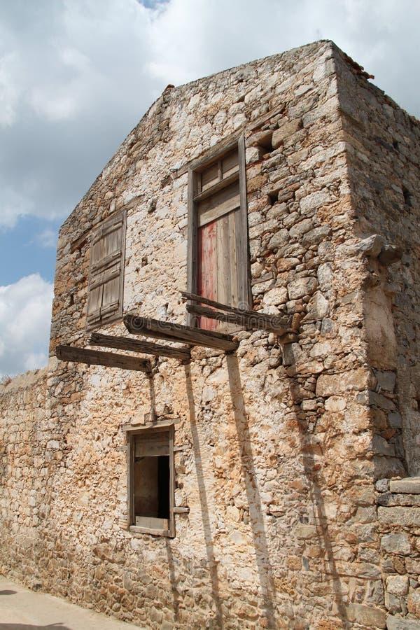 Huset fördärvar, fästningen för den Spinalonga spetälskkolonin, Elounda, Kreta arkivfoton