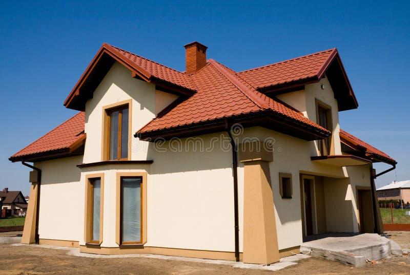 huset incompleted liten yellow royaltyfri bild