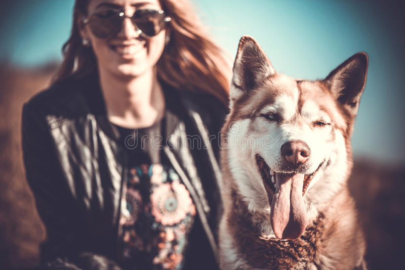 The husky dog and happy girl behind royalty free stock photo