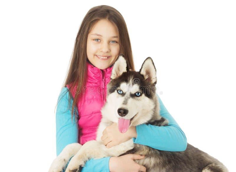 husky siberian för flicka arkivfoto