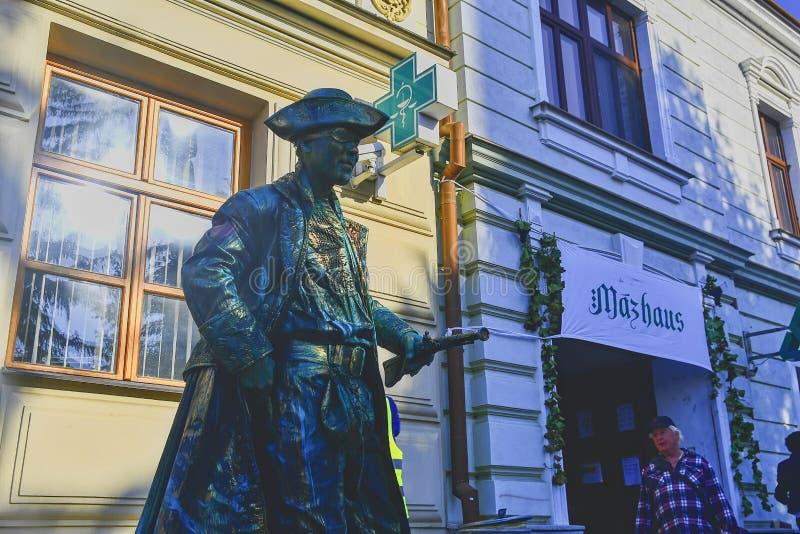 Cupreous painted artist like living statue dressed like pirate. Living statue of corsair. Living statue street performer. Living. HUSTOPECE, CZECH REPUBLIC stock photo