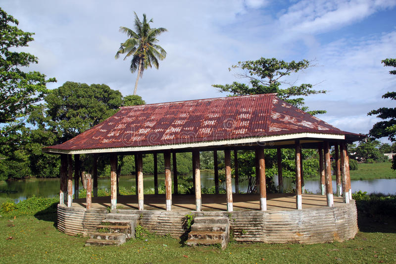 Hut. With rusty iron roof on the grass near lake in Upolu, Samoa royalty free stock images