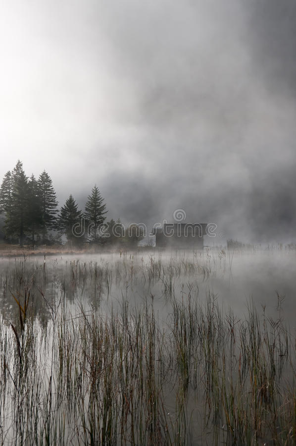 Hut in autumn-fog stock photography