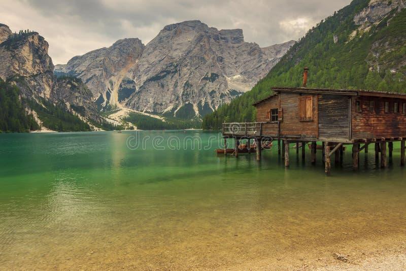 Hut on Braies Lake in Dolomiti mountains and Seeko. Braies Lake in Dolomiti mountains on a cloudy day,Trentino Alto Adige,Italy stock photos