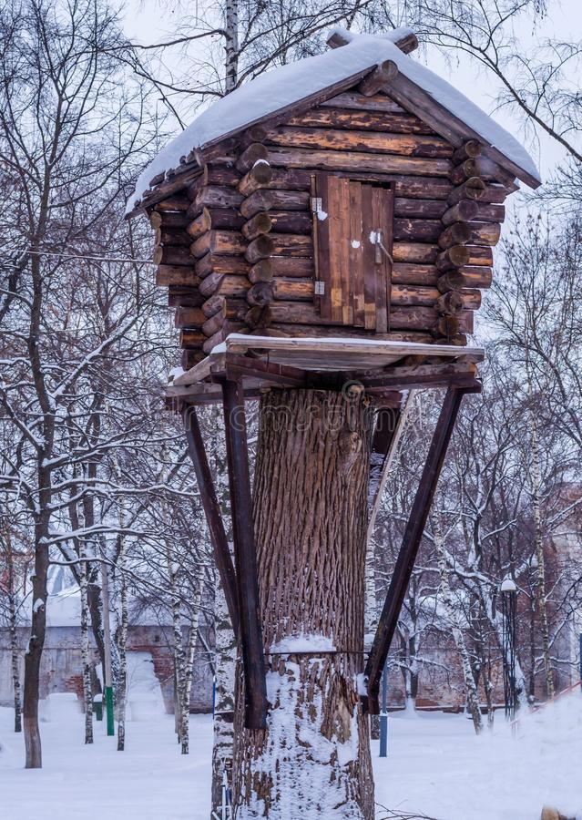 Hut on chicken legs on a tree in the winter fairy forest stock photos