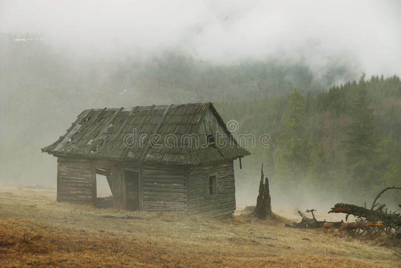 Hut in a foggy morning