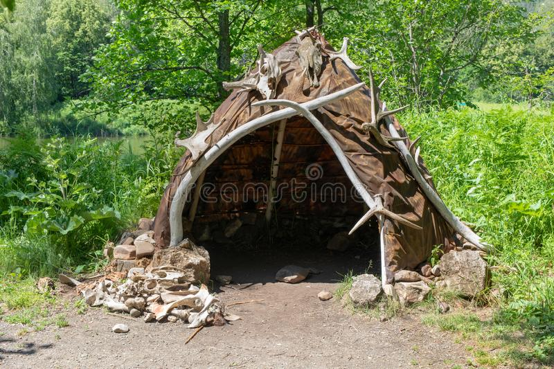 Hut made of animal skins and bones. Reconstruction of the human home of the Stone Bronze Age. stock image
