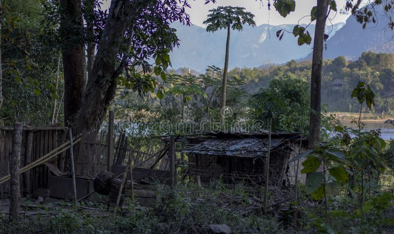 Hut in jungle, Laos royalty free stock photography