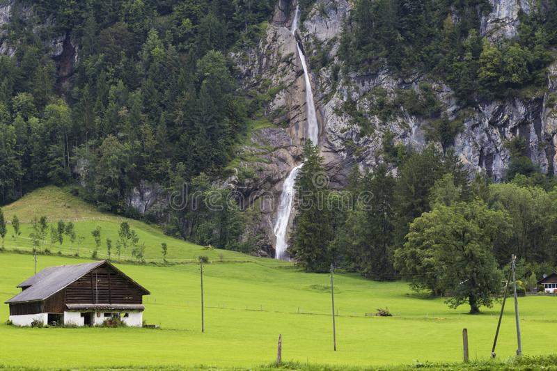 Hut in the mountains. Alpine mountain landscape . Summer in Swiss Alps . stock photo