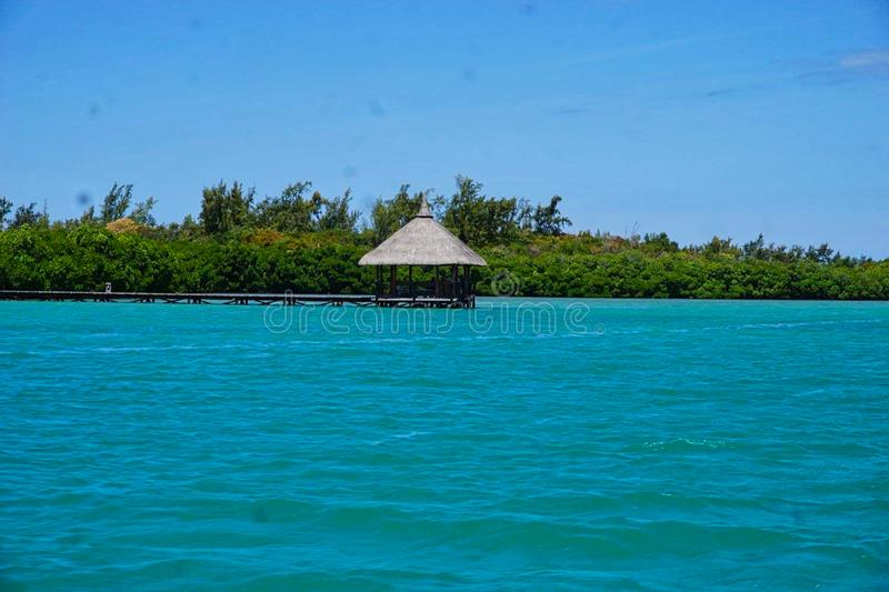 A hut in the sea. At summer, villa, moorea, tropical, water, vacation, rest, indian, roof, island, travel, hotel, romantic, coral, exotic, turquoise, paradise stock photography