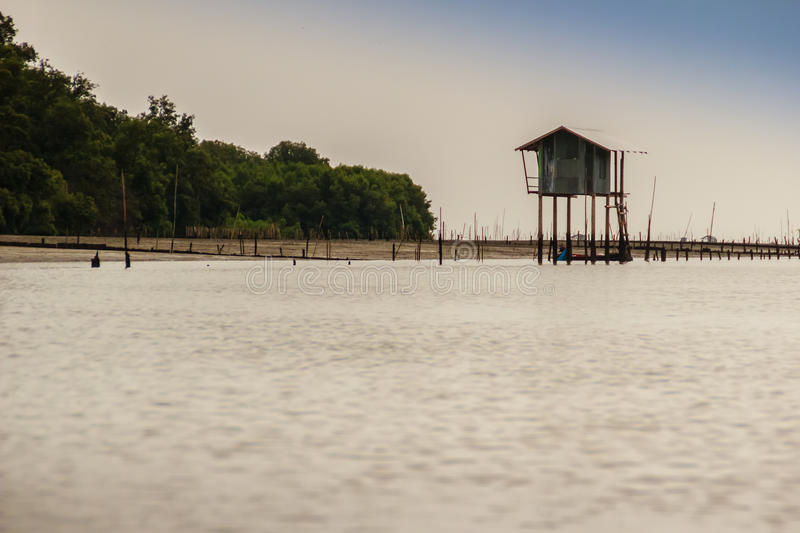 Hut in the sea that used for the owner to stay and guard his cockle farm in Samut Songkram, Thailand stock photos