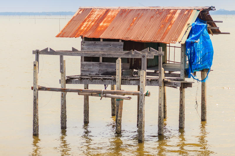 Hut in the sea that used for the owner to stay and guard his cockle farm in Samut Songkram, Thailand stock photo