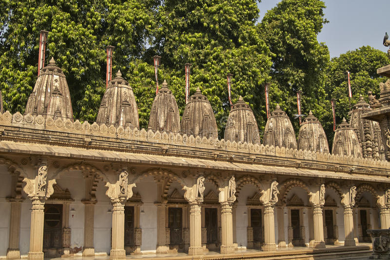 Hutheesing Temple in Ahmadabad, Gujarat, India. Ornately carved stonework of a colonnade surrounding the courtyard of the Hutheesing Temple in Ahmadabad, Gujarat stock photography