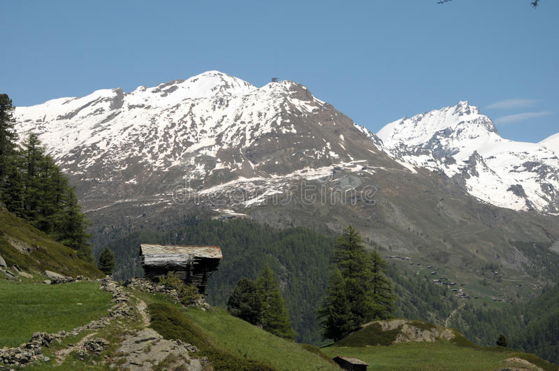 Huts and chalets in the village of Zmutt. In the Swiss Alps stock image