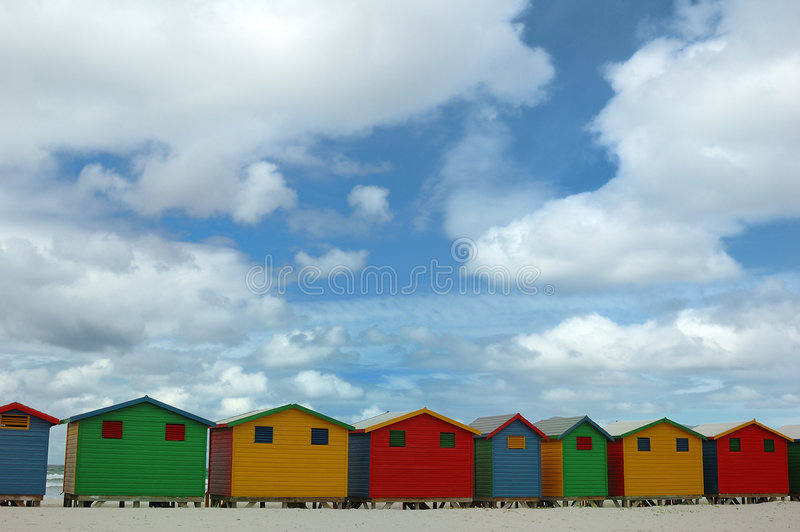 Huts on Muizenberg beach. Scenic view of colorful bathing huts on Muizenberg beach with cloudscape background; Cape Town, South Africa stock photo