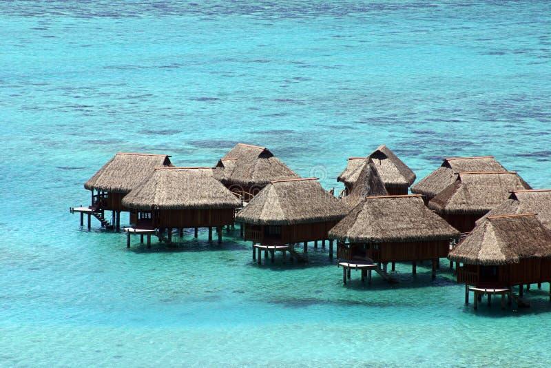 Huts in Tahiti. Resort hotel rooms over the ocean in Tahiti stock image