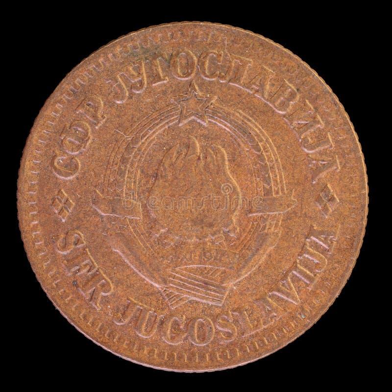 Huvud av det 10 dinar myntet som utfärdas av Jugoslavien i 1974 som visar vapenskölden av det socialistiska Förbundsrepublikenet  arkivbilder