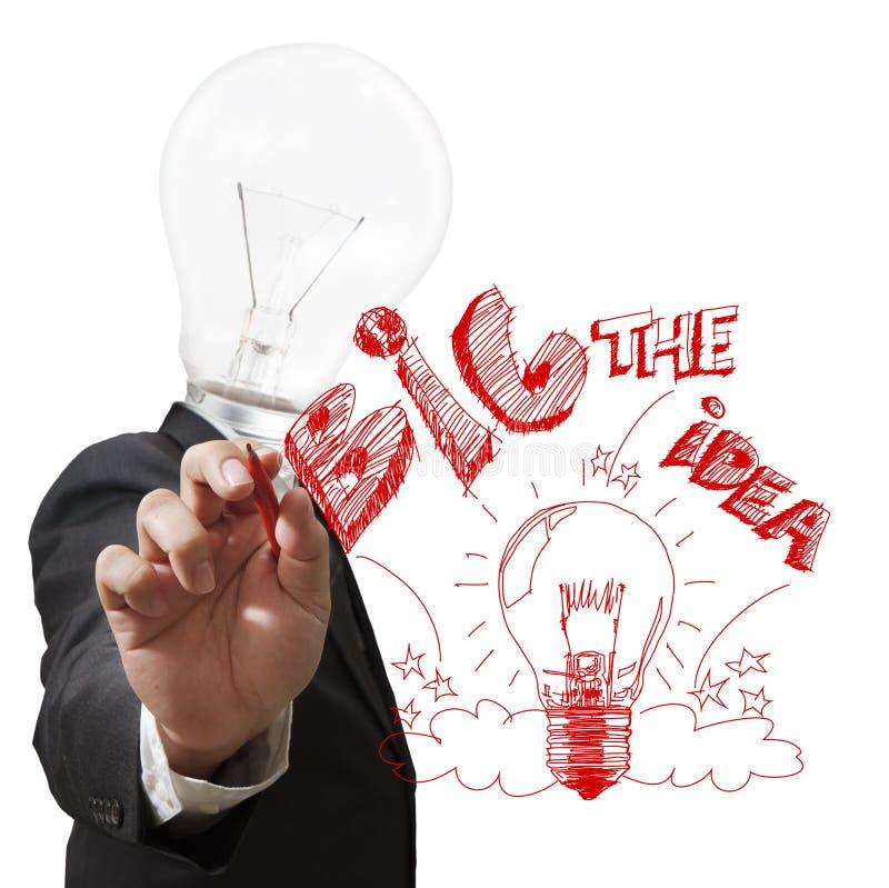 Huvudet för den ljusa kulan drar den stora idén med den röda pennan arkivbild