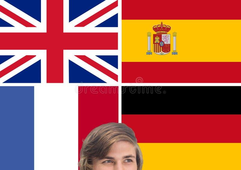 huvudsakliga språkflaggor runt om att tänka för ung man royaltyfri bild