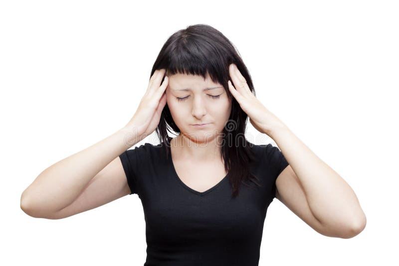 Huvudvärkkvinna. Lida från tinnitus. arkivbild