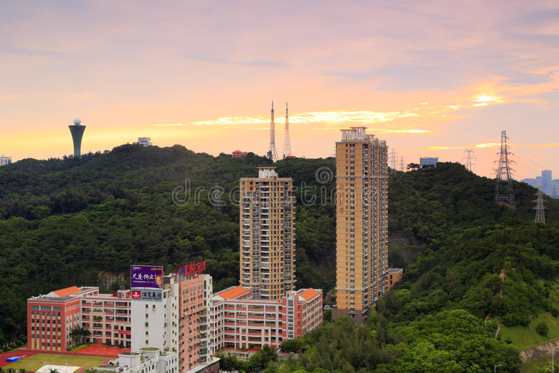 Huweishan hill residential area sunset. Huwei hill and the residential area at the foothills at seaside, amoy city, china stock photo