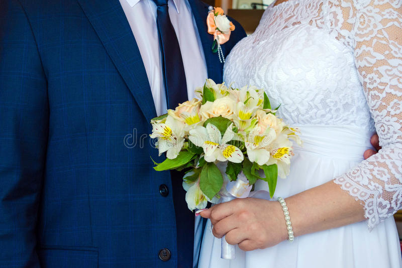 Huwelijksboeket van lelies stock foto