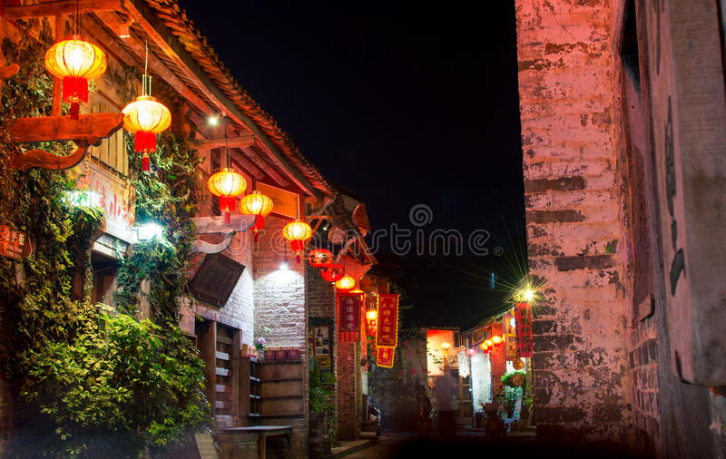 HUZHOU, CHINA - MAY 2, 2017: Huang Yao Ancient Town street in Zhaoping county, Guangxi province. Night view of traditional Chines stock photo