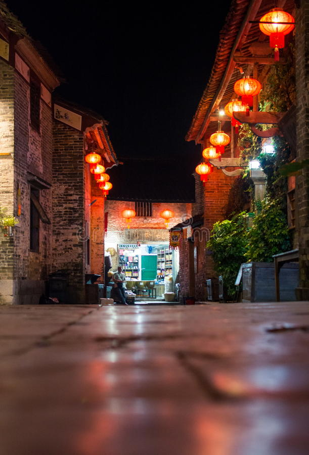 HUZHOU, CHINA - MAY 2, 2017: Huang Yao Ancient Town street in Zhaoping county, Guangxi province. Night view of traditional Chines royalty free stock photos