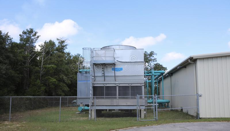 HVAC Industrial Unit. A industrial air conditioning unit installed on the outside of a building stock images