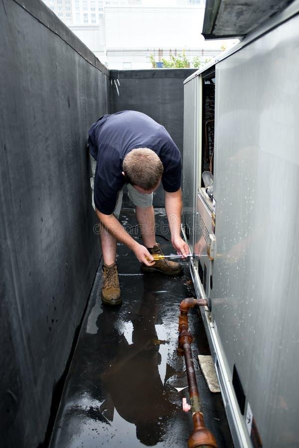 HVAC Technician Working stock photography