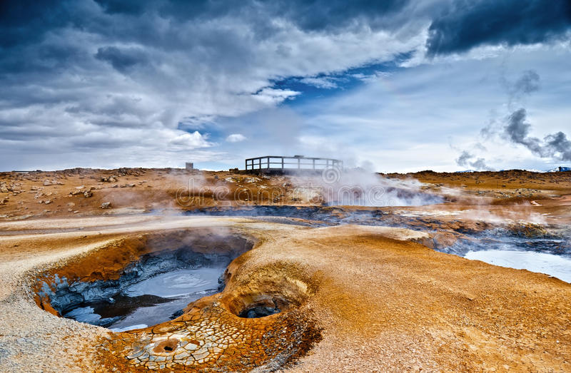 Volcanism in Iceland. Steaming mud volcano and fumaroles at a highly active geothermal area in Iceland royalty free stock photo