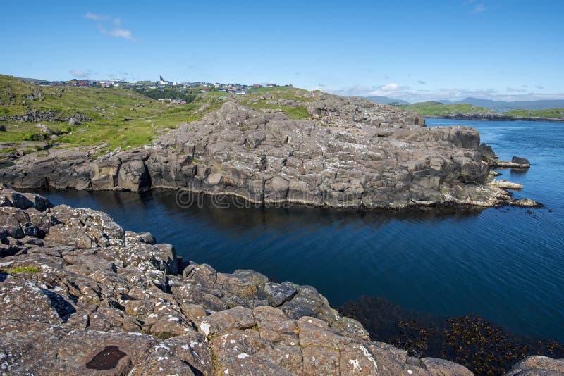 Hvitisandur Seashore landscape in Faroese island of Streymoy. Near Torshavn. Hoyvik agglomeration is at background stock photo