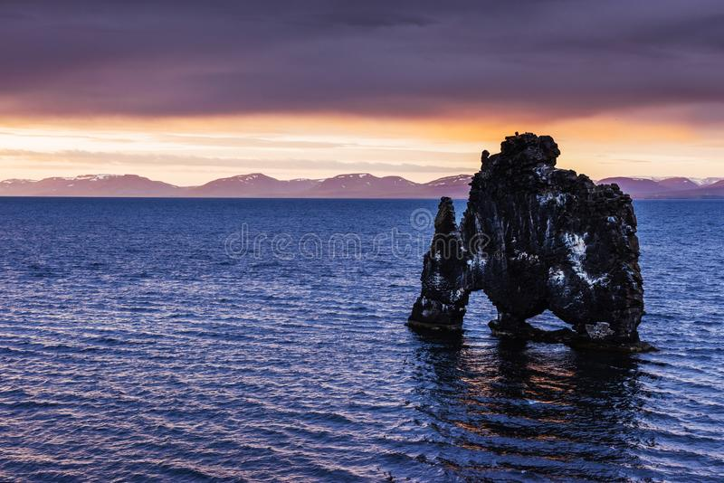 Hvitserkur 15 m height. Is a spectacular rock in the sea on the Northern coast of Iceland. this photo reflects in the water aft royalty free stock images