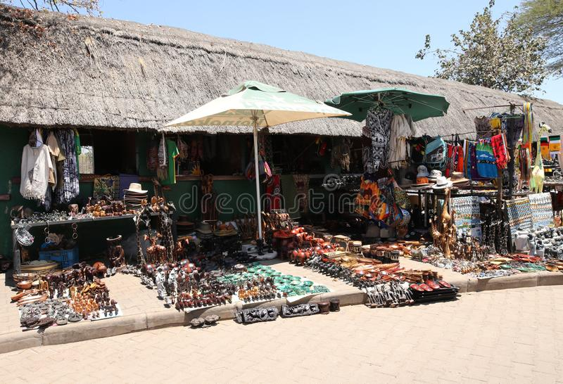 Local souvenirs on display at the street market near Victoria Falls National Park entrance on the Zimbabwe side. HWANGE, ZIMBABWE - OCTOBER 3, 2018: Local stock image
