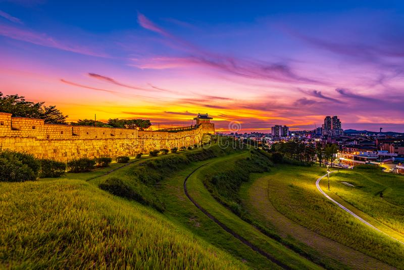 Hwaseong Fort in beautiful sunset, traditional Korean architecture in Suwon city, South Korea.  stock photo