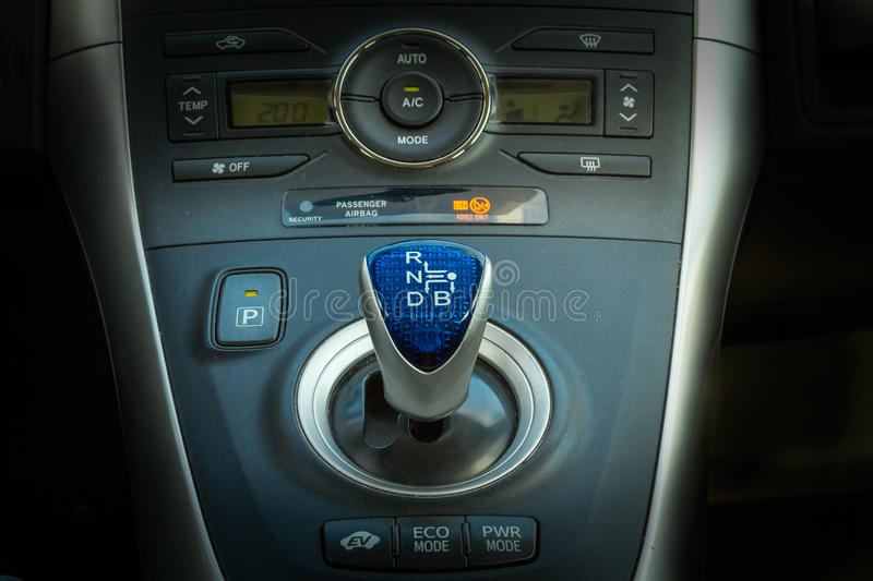 Hybrid car automatic gearbox gray and blue handle royalty free stock photo