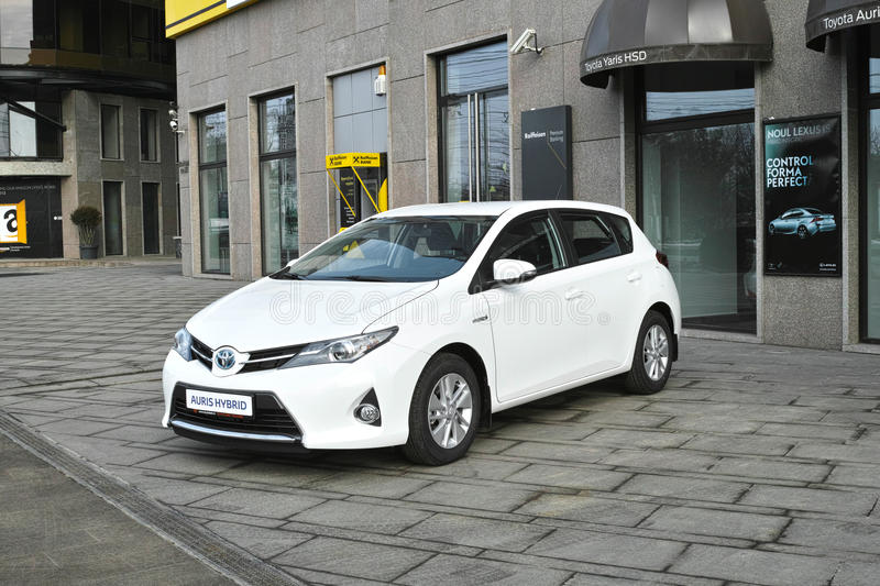 Hybrid car parked. Toyota Auris hybrid electric car parked in front of the Toyota showroom stock photography
