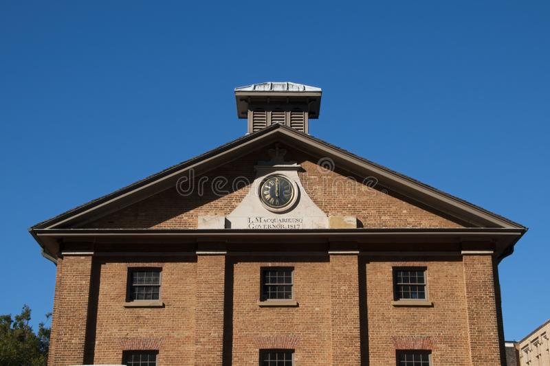 Hyde Park Barracks facade with clock, built in 1818 to house male convicts. Autumn / Winter streetscape in Sydney, Australia stock photos