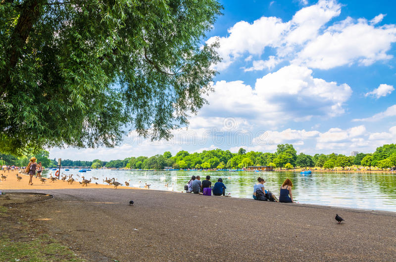 Tourists enjoying the summer weather at Hyde Park in London royalty free stock photo