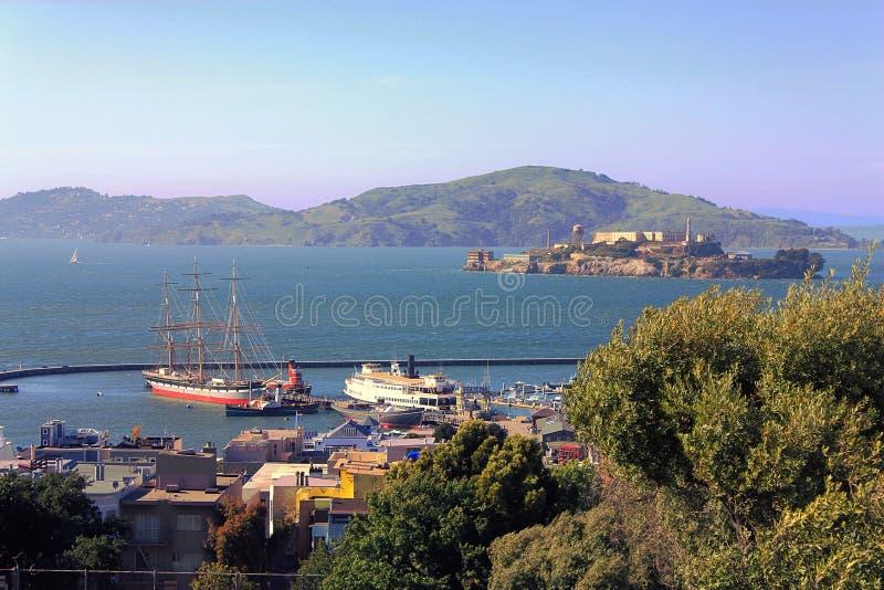 Hyde Street Pier and Alcatraz Island in San Francisco Bay, San Francisco Maritime National Historic Park, California, USA. View of Hyde Street Pier and Alcatraz stock photo